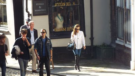 5pm: The principle leaves a shop in Elm Hill, surrounded by the bodyguard team. Picture: Elite Train