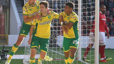 Onel Hernandez and Jordan Rhodes celebrate with Timm Klose, after he equalises for Norwich City at N