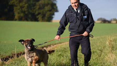 RSPCA Inspector Dean Astillberry with one of the dogs, believed to be a leonberger type dog, that we