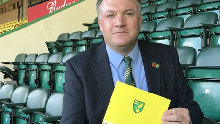 Norwich City Chairman Ed Balls with a copy of the annual report for 2018. Picture: Neil Didsbury