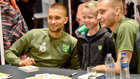 Jack Samuel with Norwich City footballers Moritz Leitner and Tom Trybull at Jarrold Intersport.Pictu