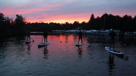 Paddleboarding at sunset. Picture Norfolk Outdoor Adventures