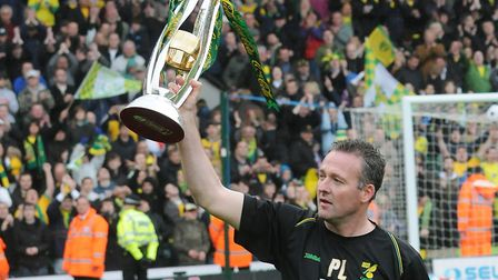 Paul Lambert celebrates with the League One title at Carrow Road Photo: Nick Butcher