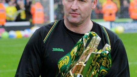 Paul Lambert with the League One trophy Picture: Nick Butcher