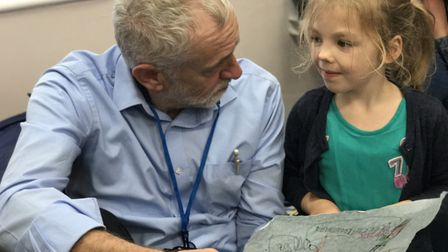 Labour leader Jeremy Corbyn chatting to a young girl at the North City children's Centre which has b