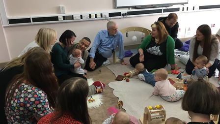 Labour party leader Jeremy Corbyn talks to parents and staff at the North City Children's Centre in