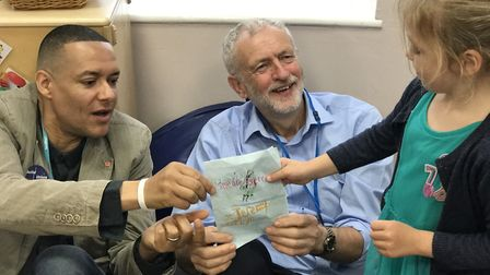 Norwich South MP, Clive Lewis and Labour leader Jeremy Corbyn receive a card from one of the childre