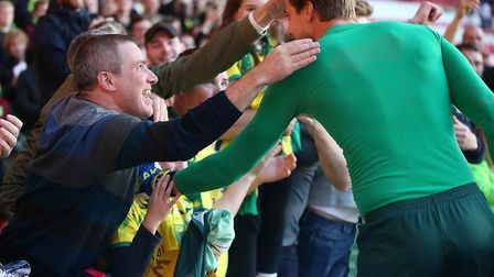 Tim Krul enjoys the moment with Norwich City's traveling fans following their recent victory at Nott