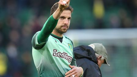 Tim Krul gives the Norwich City supporters at Carrow Road a big thumbs up following victory over Bre