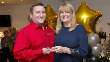 Clinical Educator Wayne Butler receives the award for Delivering Exceptional Care from Director of H
