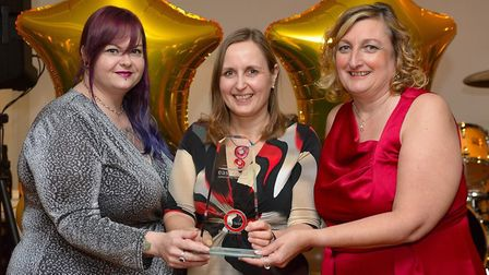 Speech and Language Therapy administrator Donna Overton collects the Emerging Talent award from ECCH