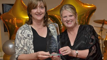 Children's Speech and Language Therapist Julie Pass (left) is presented with the Making a Difference