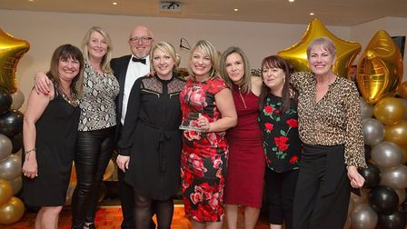 ECCH Chief Executive Jonathan Williams (third from left) presents the Non-Clinical Team of the Year