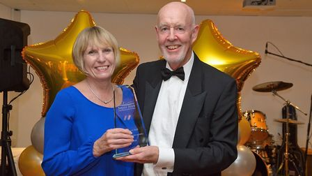 Continence Specialist Nurse Anne Weale receives the Lifetime Achievement Award from ECCH Chair Tony