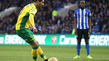 Mario Vrancic gets in a tangle as he has to watch is early penalty save against Sheffied Wednesday.