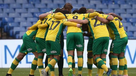 The Norwich City squad prepares for kick-off with their customary matchday huddle. Picture by Paul C