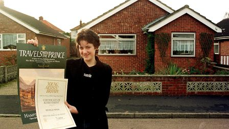 Michelle Heron in 1998 with her certificate from Young Artist's Britain signed by Prince Charles (C)