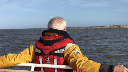The Archbishop of Canterbury takes a moment to enjoy the seals off the Caister coast. Picture: Neil