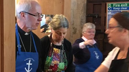 What are you having? The Archbishop of Canterbury serves breakfast at Blakeney church. Pictures: Dio