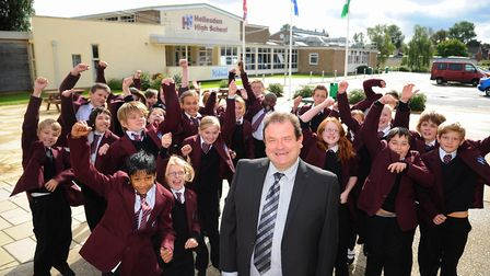Gerry Batty with pupils at Hellesdon High School in 2013. Mr Batty is stepping down as chief executi