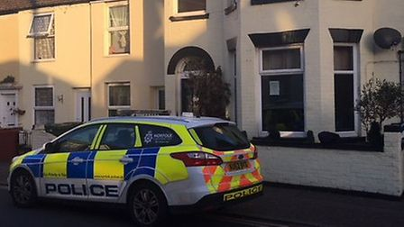 Police outside a property in Great Yarmouth where a man was stabbed to death. Picture Liz Coates.