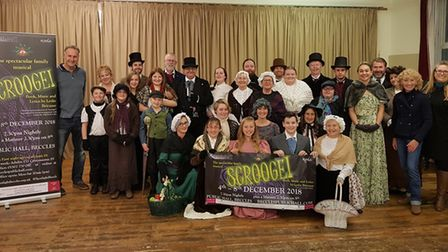 Norton Peskett chief executive Bob Bryant, left, with the production team and cast of Scrooge! Pictu