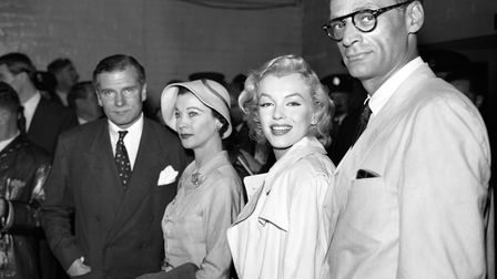 Sir Laurence and Lady Olivier at London Airport meeting Marilyn Monroe and her husband playwright Ar
