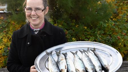Vicar of Pakefield, Reverend Sharon Lord, with the tray of herring ahead of the annual Blessing of t