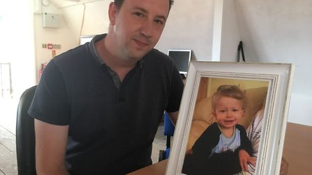 James Sinclair, with a photograph of his son Dylan, who died in March 2015 at the age of seven. Pict