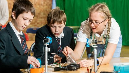 Workshop co-ordinator Emily Fisk shows students how wind turbines generate energy. Picture: Scottish
