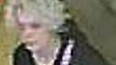Police want to identify this woman after cash was taken from a till in Poundland Picture: Norfolk Po