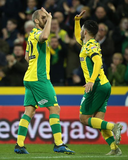 Teemu Pukki celebrates with Emi Buendia after his first goal against Millwall Picture: Paul Chestert