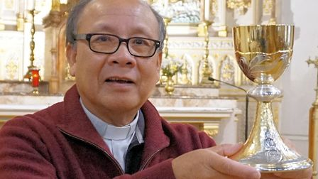 Our Lady Star of the Sea Church Parish Priest Fr Paul Chanh with the new chalice. Picture: Tony Walm