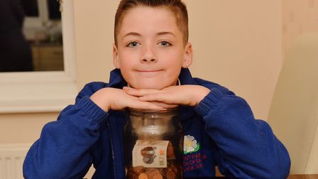 Hayden Iley from Long Stratton used his pocket money to help a homeless man in the village.Byline: S