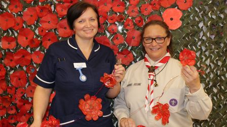 West Newton Ward Manager Donna Snowden and Akela Lesley Doherty hold some of the poppies made by the