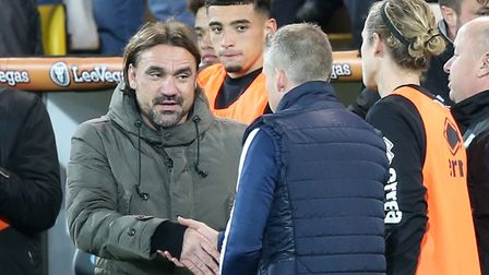 Neil Harris shakes hands with Daniel Farke after a frenetic end to Norwich City's 4-3 Champonship wi