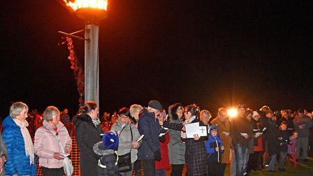 Rev Sharon Lord with some of the 42 people each reading out a name of those from Pakefield who had d