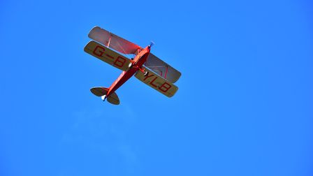 The biplane flypast over St Catherine's church in Ludham during the Remembrance Day service. Picture