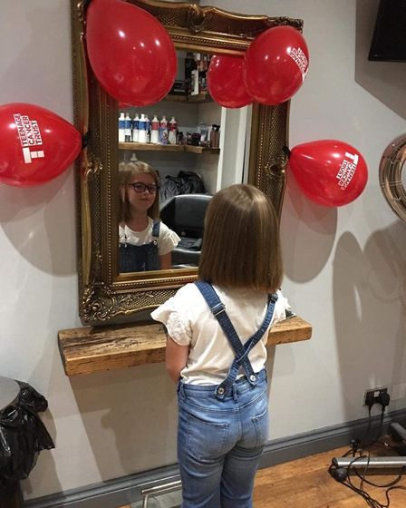 Amelia, 9, decided she was lucky to have such long hair and wanted to donate some of it to the Litt