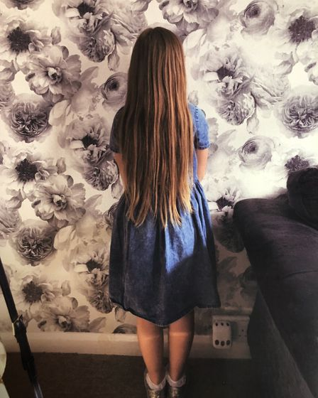 Amelia raised more than £1,300 for the Teenage Cancer Trust and donated her hair ro be sculpted into