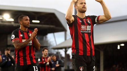 Simon Francis leads the celebrations after Bournemouth's 3-0 weekend win at Fulham in the top flight