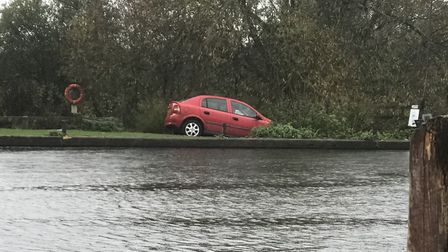 The car, a red Vauxhall Astra, remained on the edge of the river bank on Ferry Road today, opposite