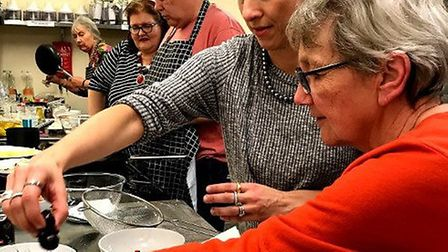 Chef Lola De Mille works with adult family carers at a previous session. Picture: Suffolk Artlink