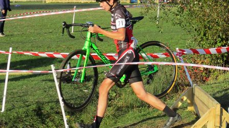 Junior winner Angus Toms at the unusual hurdle and ditch combination at the Grafham Water cyclo-cros