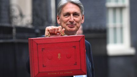 Chancellor Philip Hammond holding his red ministerial box outside 11 Downing Stree before heading to