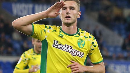 Dennis Srbeny scored twice as Norwich City knocked Premier League side Cardiff out of the carabao Cu