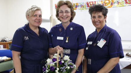 Claire Roberts, centre, is wished well by chief nurse Emma Hardwick (left) and deputy chief nurse Va