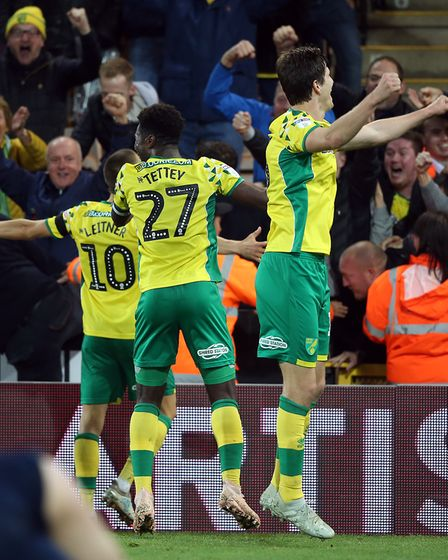 The Norwich players celebrate their sideÕs 4th goal during the Sky Bet Championship match at Carrow