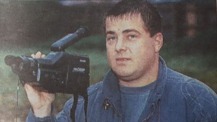 Glen Webster with the camcorder he used to capture the silent object over his Mile Cross home. Date: