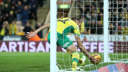 Jordan Rhodes rushes to collect the ball after scoring City's equaliser - it was well worth the effo